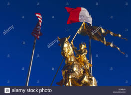 French Flag Background Golden Joan Of Arc On Horseback Sculpture With Us And French Flags