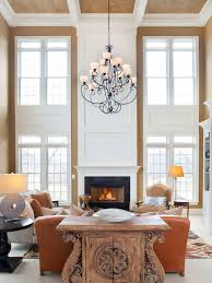 interior shabby white living room with bay windows that have