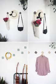 10 simple and modern hooks to decorate any wall contemporist these geometric ceramic wall hooks designed in a variety of shapes sit away from the wall slightly to allow a coat hanger or back to hang behind the hook