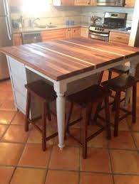 diy created this by using the bottom half of the kitchen dining