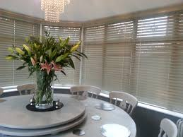 green wooden venetian blinds for the conservatory http