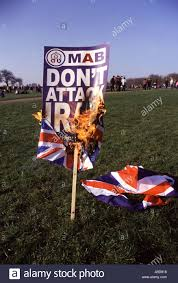 Flag On Fire Banner And Union Jack Flag That Was Set On Fire At The London Hyde