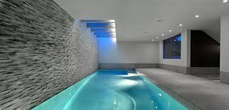 creative indoor swimming pool with open design and nice lighting