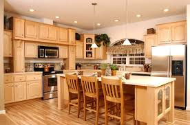 kitchen ideas with maple cabinets maple kitchen cabinets with black appliances home design ideas