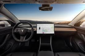 futuristic cars interior tesla model 3 s futuristic interior is unlike any other car we ve