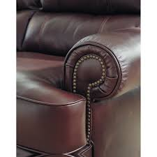 sofa match wing back leather match sofa with coil seat cushions by signature