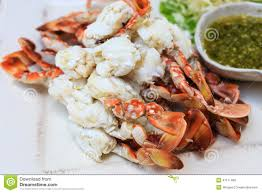 steamed crab legs with thai spicy seafood sauce stock photo