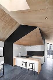 mur noir cuisine 1001 idées cuisine noir mat et bois élégance et sobriété