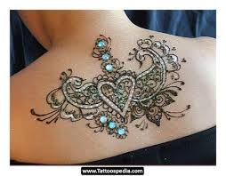 love the subtle colors in this shoulder tattoos for women