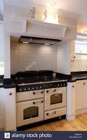 range oven in modern country style kitchen cheshire uk stock