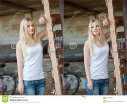 shot of beautiful near an old wooden fence stylish look wear