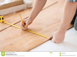 Measuring For Laminate Flooring Close Up Of Male Hands Measuring Wood Flooring Stock Photo Image