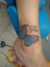 colored butterfly on ankle tattooshunt com