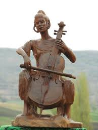 small wooden sculptures sculpture violoncello small carved wood musician statue by