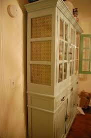 china cabinet organization ideas i m not wild about the fabric choice but i like the idea for a