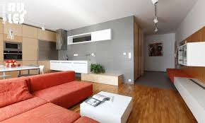 grey wall paint color for living room with red sofa and wooden