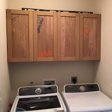 best place to buy cabinets for laundry room how to build cabinets laundry room makeover