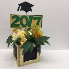 graduation centerpiece glittered black and gold masonjar grad