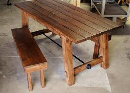 rustic farm table testing the bench support for fit and