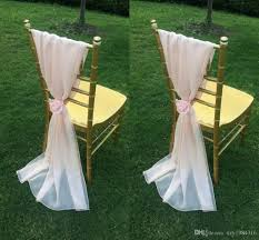 blush pink chiffon chair sashes with flowers floor length ruffles