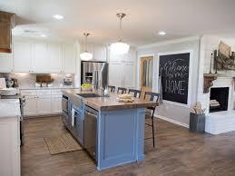 fixer blue kitchen cabinets contemporary neutral kitchen with blue island hgtv