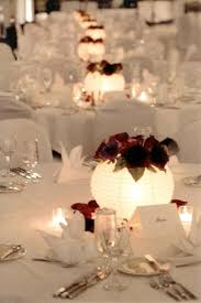 cheap lantern centerpieces not with flowers but paper lanterns and led tealights for