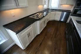 white kitchen cabinets with antique brown granite millennium granite countertop by msi granite