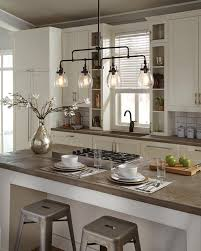interior kitchen island and barstools with seagull lighting also