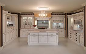 traditional kitchen cabinets with white decoration and chandeliers