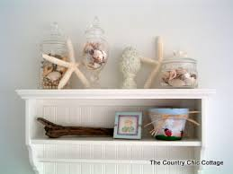 seashell bathroom decor ideas seashells bathroom decor shelf vignette 8 decorizeme