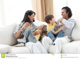 Merry Family Playing In The Living Room Royalty Free Stock Photo - Family in living room