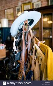 western tack and a cowboy hat on a coat rack stock photo royalty
