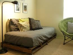 bedroom boys bed room with pallet day bed on wheels having grey