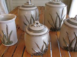 brown kitchen canister sets stoneware canister set naturalistic design cattails canister