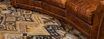Orange And Brown Area Rugs Area Rugs Versus Wall To Wall Carpet Brumbaugh U0027s Fine Home