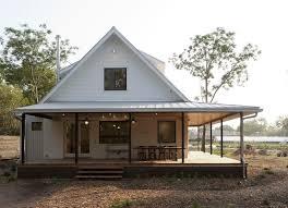 farmhouse with wrap around porch porch designs porch farmhouse with white house standing seam roof
