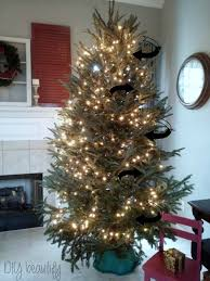 how to put lights on a christmas tree video tips for decorating a christmas tree diy beautify