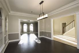 two tone wall with chair rail and dark hardwood dining room