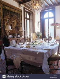 pale grey cloth on table set for lunch in french country dining