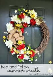 summer wreath and yellow summer wreath with a burlap bow