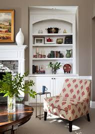 a taupe wall color paired with a white built in bookshelf cabinet