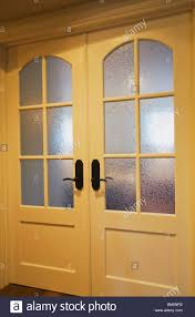 frosted glass french door french doors with frosted glass panels in a home stock photo