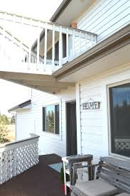 Sherwin Williams White Exterior Paint - the house has been painted little vintage nest