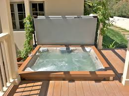 jacuzzi jlx spa surrounded by flagstone backyard designs with