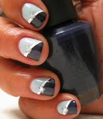 beautiful styled nails black and a lighter blue with a star in