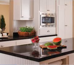 timeless kitchen design elements tips advice granite contrasting black countertops with white cabinets are complementary in kitchen design