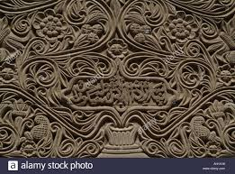 detail of swahili carved door frame with arabic writing lamu