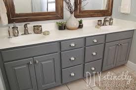 how to repaint bathroom cabinets grey bathroom cabinets new painted bathroom cabinets diystinctly