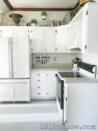 how to paint my kitchen cabinets white how not to paint your kitchen cabinets 1915 house