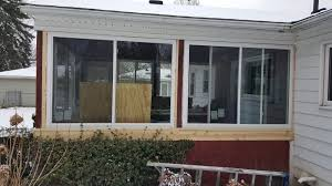 installing 3 season porch windows on sligh st all in one builders